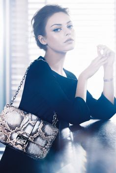 The lighting is crazy bright! Also Mila Kunis is awesome.   Christian Dior s/s 2012