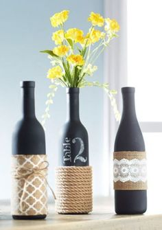 Twine Wrapped Centerpieces: Twine gives these pretty wine bottle vases an outdoor charm that will look great on any porch.