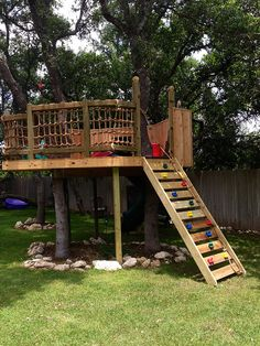 Super dad Treehouse: My husband built this for our daughter's 3rd Birthday. It took about a month working on Saturdays and Sundays only. We plan to add to it as the kids grow up. Absolutely amazing. He had no plans, just made it up as he went.