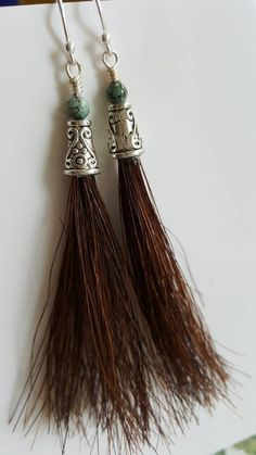 Check out this item in my Etsy shop https://www.etsy.com/listing/475891785/turquoise-and-horsehair-tassel-earrings
