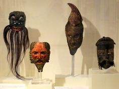 Masks: These four unique masks demonstrate the creative use of natural materials to portray certain figures. Masks are the most ancient means of changing one's identity and assuming a new persona. Varying degrees of facial hair are portrayed in these masks, using fibers, horsehair, or varying textures in the carved wood surface.