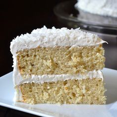 This Coconut Velvet Cake is beautifully moist & tender, flavoured with coconut milk & extract, then covered in coconut marshmallow frosting & dried coconut.