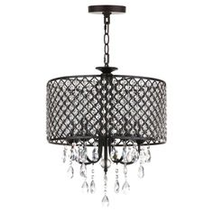 Inspired by the industrial chic vibe of London's hottest riverside loft homes, this contemporary chandelier is gem. The juxtaposition of its modern iron perforated shade and opulent prismatic crystals elevates any interior.