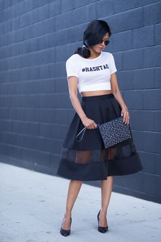 Sheryl from @WALK IN WONDERLAND is looking totally hot in an #Express full skirt with a mesh inset. #streetstyle #fashion