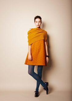 Mustard tunic and gray tights