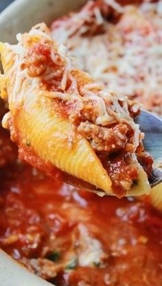 Lasagna Stuffed Shells Recipe 20 jumbo shells 3/4 cup ricotta cheese 1 cup mozzarella cheese 1/4 cup Parmesan cheese 1 egg 1/4 cup frozen spinach, thawed and drained 2 cups of your favorite tomato sauce 1 lb. sausage