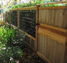 recycled cedar art fence & interesting mix of materials handle a sloping yard