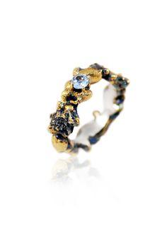 Der wunderschöne Ring ist sehr aufwendig angefertigt um die farbenfrohe und geheimnisvolle Welt der Meerestiefen zu zeigen.