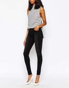 Skinny jeans by Monki Stretch denim Washed finish Zip fly Five pocket styling  Super skinny - cut closest to the body.