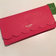 Free shipping now! Red Kate spade clutch NWT Also have Michael kors, smashbox, Kate spade, urban decay, Mac, Nike, fossil and much more! Comes with dust bag and has a wrist strap kate spade Bags Clutches & Wristlets