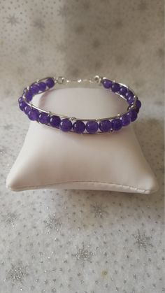 Check out this item in my Etsy shop https://www.etsy.com/uk/listing/400813187/wirework-amethyst-channel-set-bracelet