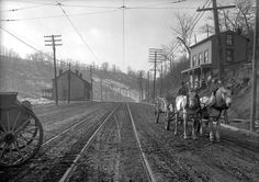View of West Liberty Avenue in 1915, looking south and showing condition of the street at Pioneer Avenue.