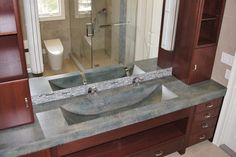 Royal Cabinet & Stonehenge Concrete Countertops created this innovative concrete sink. #bathrooms @KitchenBathChan
