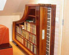 Damaged and rescued Grand piano repurposed into wooden bookcase shelves.  Salvage, upcycle, recycle!  Love this idea!