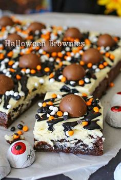 Halloween Brownies - These Halloween Brownies are a fudgy brownie topped with white chocolate frosting, black icing, funfetti sprinkles & DOVE® Milk Chocolate Eyeballs. Making Halloween treats just got easier! on kleinworthco.com #FallFlavors #ad @target