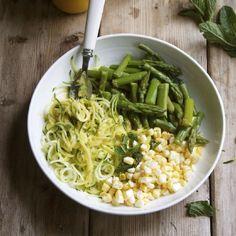 Raw Zucchini Noodles with Steamed Asparagus, Raw Corn & a killer Mango Sriracha Dressing. Make it sans Sriracha for  a healthier fix