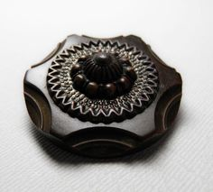 Brown Bakelite Coat Button with Escutcheon by ButtonsFromTheAttic, $15.00