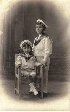 TWO SAILOR BOYS WITH HMS DEVONSHIRE CAP TALLIES