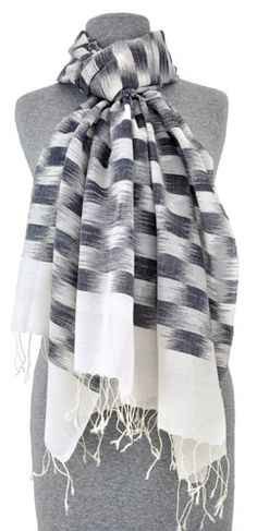 This lightweight summer scarf is hand woven in cotton with subtle ikat patterning.
