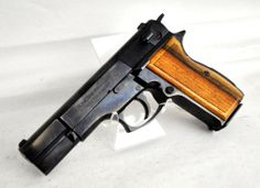 "FEG P9R-HP 9mm: The P9R is a 9mm DAO pistol manufactured by FEG (Fegyver es Gepgyar) in Hungary, and is modeled after the Browning Hi-Power. It features a carbon steel frame and slide with a blued finish, and checkered wood grips. Fixed sights. 14-round capacity of 9mm. 4.64"" (118mm) barrel. 36 oz. [pre-owned] $399.99"
