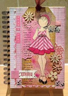 Altered notebook using prima doll stamp.