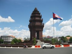 City of Four Faces #IndependenceMonument http://happyfrogtravels.com/city-of-four-faces-phnom-penh-cambodia/