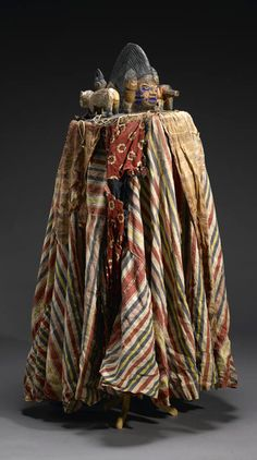 Africa | Egungun headdress and costume from the Yoruba people of Nigeria | Wood, hand woven and commercial print cotton cloth, velvet, felt, burlap, leather, pigment, twine, nails