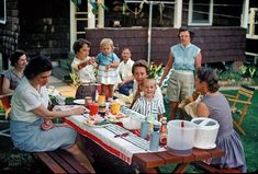 """June 1960 somewhere in Maryland. """"Picnic in yard."""" Janet, of Kermy and Janet, pointing at the camera. Who wants more potato salad"""