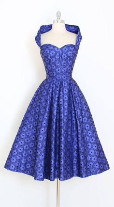 ➳ vintage 1950s dress * stunning convertible halter dress * royal purple brushed cotton * covered in black floral embroidery * wide halter neck strap * wear off shoulders or twisted * full skirt * bodice stays * metal zipper * pockets!! condition | excellent fits like xs/s length 48 bodice 18 bust 36 waist 26 bodice allowance 3 ➳ shop http://www.etsy.com/shop/millstreetvintage?ref=si_shop ➳ shop policies http://www.etsy.com/shop/millstreet...