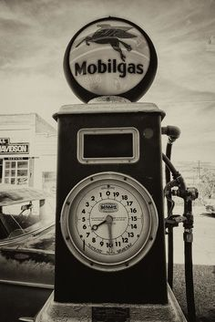 """Close-up of a vintage """"Mobilgas"""" pump showing the gallon dial and fueling hoses on Erie Street in Lowell, Arizona. Every photo is available as a Fine Art Print. Decorate your home or office with a high quality Canvas, Metal, Acrylic or Wood Print. Posters and matted and framed prints are also available."""
