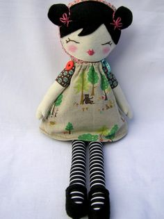 WANNA MAKE. Mieko is a one of a kind cloth doll. Her body is made of soft wool suiting and her hand embroidered face is made from pure wool felt. Her caplet is made of hounds tooth tweed and dose up with a wooden button on the front. Her little arms are sewn securely on with buttons so they can be moved about. Just to finish off she has stripy cotton leggings and little pink bows in her hair. Mieko stands 16 inches tall from her head to her tippy toes.