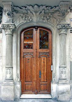 Stunning Classical Architecture stone door surround in Barcelona. Photo by Arnim Schulz