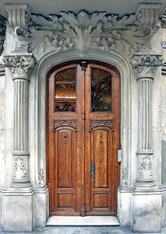 Stunning Classical Architecture stone door surround in Barcelona.  Photo by Arnim Schulz