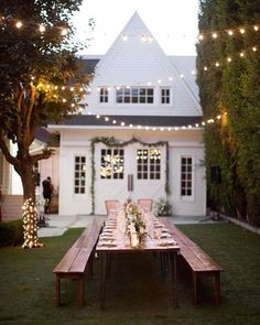 Beautiful outdoor greenery table! With lights & rustic chairs - love it! #outdoorwedding #rusticwedding