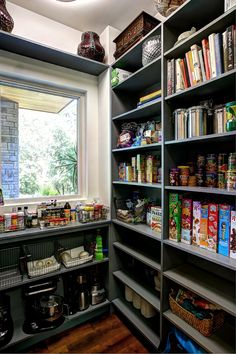 Pantry with open shelves to store dry goods, cookbooks, and small kitchen appliances