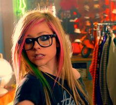 I'm a weirdo. And I had to get glasses. I look like a nerd. *I laugh* anyone wanna hang out?-Avril