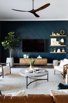 Can't get over the colors, rich wood tones and textures of this living room. 😍 Featuring the Stratus Coffee Table Photography by Accent Walls In Living Room, Living Room Tv, Home And Living, Dark Living Rooms, Blue Feature Wall Living Room, Blue Living Room Decor, Living Room Colors, Living Room Modern, Blue And Brown Living Room