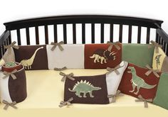 Now you can complete your nursery décor with this darling Dinosaur Land crib bumper. This striking design features wonderful, detailed embroidery and appliqué works of dinosaurs like the Pterodactyl, T-rex and Brontosaurus. $69.99 - Shop www.DinosaurToysSuperstore.com