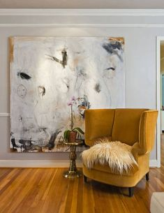 The wingback chair is a custom piece from Pritchard's design studio, upholstered in Schumacher's rusty orange velvet.  The abstract painting is from Dallas Artist Chris Schumacher.(463×600)  || http://www.dallasnews.com/incoming/20110128-home007.jpg.ece/BINARY/original/home007.JPG