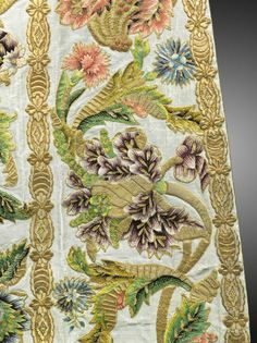 Austria, about 1760. Set of liturgical vest, off-white silk and silver cope embroidered with pink, purple, green, and gold floral and cornucopia motifs. Trimmed in thick gold embroidery.