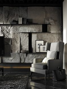 PIN 8 a statement-making stone wall in the living room. I feel as though the is too much for this space it has swallowed the place up and the rest of the interior looks overpowered. perhaps the used of smaller stones would have balanced the room out better