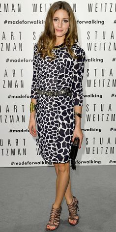 Olivia Palermo, the accessories savant, dressed up her giraffe-print long-sleeve shift with a gold-and-black necklace, statement belt, bracelets on both wrists, black clutch and Stuart Weitzman cut-out booties.