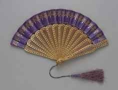 Fan Made Of Silk Satin Leaf Decorated With Brass Sequins And Spangles; Carved Wood Sticks Covered With Gold Leaf And Mother-Of-Pearl Tassel - American c. 1867-1876   -   The Museum of Fine Arts, Boston