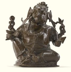 A Copper Alloy Figure of Ganesha Height: 7 5/8 in. (19.4 cm) India, Karnataka, 17th/18th century
