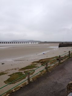 Arnside Pier in Cumbria, Cumbria. Free parking along the Promonade. Great food and beers in the Fighting Cocks pub, dogs allowed. Great views over the estuary.
