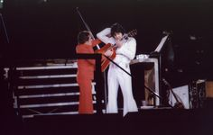 December 31, 1975 Elvis at the Pontiac Silverdome, MI | unusual stage set up. Elvis had his own stage which was higher than the band and backing singers. He also split his trousers during this show. He started off wearing the Rainfall suit but changed into the V Neck suit after the split.
