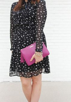 Houston Fashion Blogger, Karen Rock wears a cute long sleeve star print dress for a holiday party.