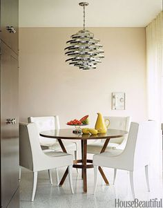 Dining Room Designs and Decor - House Beautiful - features a vintage hanging lamp made from circles of stainless steel and frosted glass.