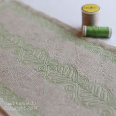 Free motion quilting:  Leaves on Linen