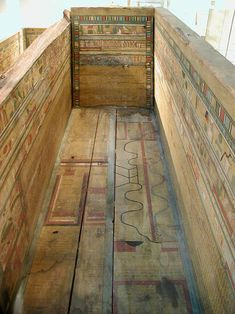 Middle Kingdom sarcophagus with the Coffin Texts painted on its panels. The Coffin Texts are a collection of ancient Egyptian funerary spells written on coffins beginning in the First Intermediate Period. The texts are derived in part from the earlier pyramid texts, reserved for